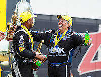 Sep 18, 2016; Concord, NC, USA; NHRA funny car driver John Force (right) celebrates with top fuel winner Antron Brown after winning the Carolina Nationals at zMax Dragway. Mandatory Credit: Mark J. Rebilas-USA TODAY Sports