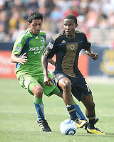 Danny Mwanga #10 of the Philadelphia Union shields the ball from Leonardo Gonzalez #19 of the Seattle Sounders FC during the first MLS match at PPL stadium in Chester, PA. on June 27 2010. Union won 3-1.