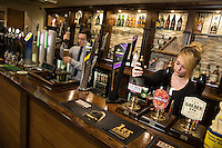 Ben Lovegrove and Samantha Adams serve up perfect pints at The Fountain Bridge carvery restaurant and pub at Kirkby in Ashfield, Nottinghamshire
