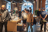 Customers flock to the new Shinola Detroit store in the Dumbo neighborhood of Brooklyn on opening day Saturday, April 15, 2017. The brand is known for its hip, designed watches, leather goods and lifestyle accessories all of which are manufactured in Detroit. The store is one of the retailers located in the Empire Stores, a renovated civil war era warehouse vacant for many years. (© Richard B. Levine)