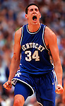 Kentucky's #34 Scott Padgett celebrates his sinking of a three point shot to take the lead over Duke 84-81 just minutes before beating Duke to advance to the Final Four, Sunday, March 22,1998 in St. Petersburg, Florida.