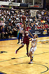 23 MAR 2012: Sequoyah Griffin (10) of Shaw goes up for a layup over Alyssa Miller (12) during the Division II Womens Basketball Championship held at Bill Greehey Arena in San Antonio, TX.  Shaw University defeated Ashland University 88-82 for the national title.  Rodolfo Gonzalez/ NCAA Photos