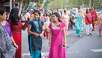 Hundreds of members of the Hindu Center march through the Flushing neighborhood in the New York borough of Queens on Wednesday, August 28, 2013 during their parade celebrating the birthday of Lord Krishna. The neighborhood of Flushing is a polyglot of ethnic cultures including Chinese, Korean, Russian, Pakistanis, Indians, Sikhs among others. (© Richard B. Levine)