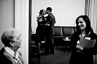Joe and his wife Lisa share a quick kiss in his new office in the Cannon House Office Building before heading to the House floor for his swearing-in as a member of Congress on Jan. 5, 2011. (Photo By Bill Clark/Roll Call)