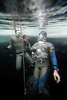 Thomas Grindevold from Norway about to surface during the freediving competition Oslo Ice Challenge at freshwater lake Lutvann, outside the Norwegian capital Oslo. Atheletes, including current and former world champions, entered a hole in the ice to compete. The participants reached depths down to 52 meters below the surface.