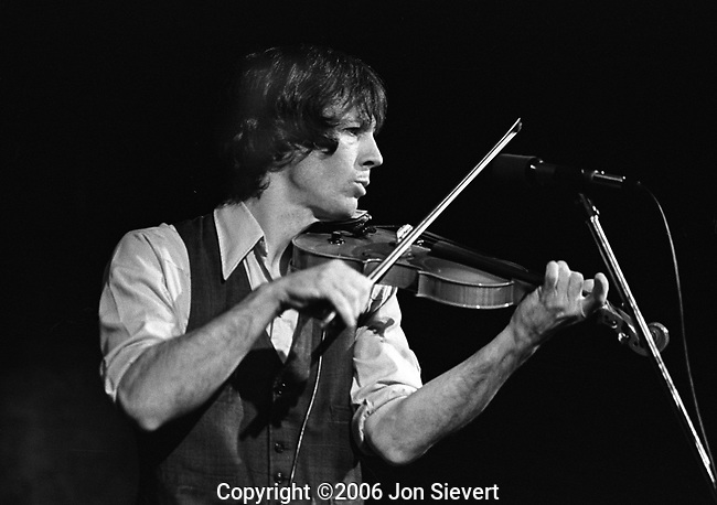 John Hartford, Dec. 9, 1978. American folk, country and bluegrass composer and musician known for his mastery of the fiddle and banjo, as well as for his witty lyrics, unique vocal style, and extensive knowledge of Mississippi River lore. Hartford performed with a variety of ensembles throughout his career, and is perhaps best known for his solo performances where he would interchange the guitar, banjo, and fiddle from song to song. He also invented his own shuffle tap dance move, and clogged on an amplified piece of plywood while he played and sang.