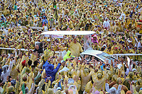 Pope Francis, wearing a yellow raincoat, waves to pilgrims after holding a mass at Tacloban's airport January 17, 2015. An emotional Pope Francis, wearing a plastic poncho over his vestments to protect him from the wind and rain on Saturday, comforted survivors of Typhoon Haiyan, the Philippines' worst natural disaster that killed about 6,300 people 14 months ago.   REUTERS/Damir Sagolj (PHILIPPINES)