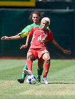 05 July 2009:  Nelson Barahona of the Panama controls the ball away from Stephane Auvray of Guadeloupe during the game at Oakland-Alameda County Coliseum in Oakland, California.   Guadeloupe defeated Panama, 2-0.