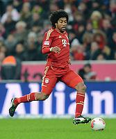 FUSSBALL   1. BUNDESLIGA  SAISON 2012/2013   15. Spieltag FC Bayern Muenchen - Borussia Dortmund     01.12.2012 Dante (FC Bayern Muenchen)  am Ball
