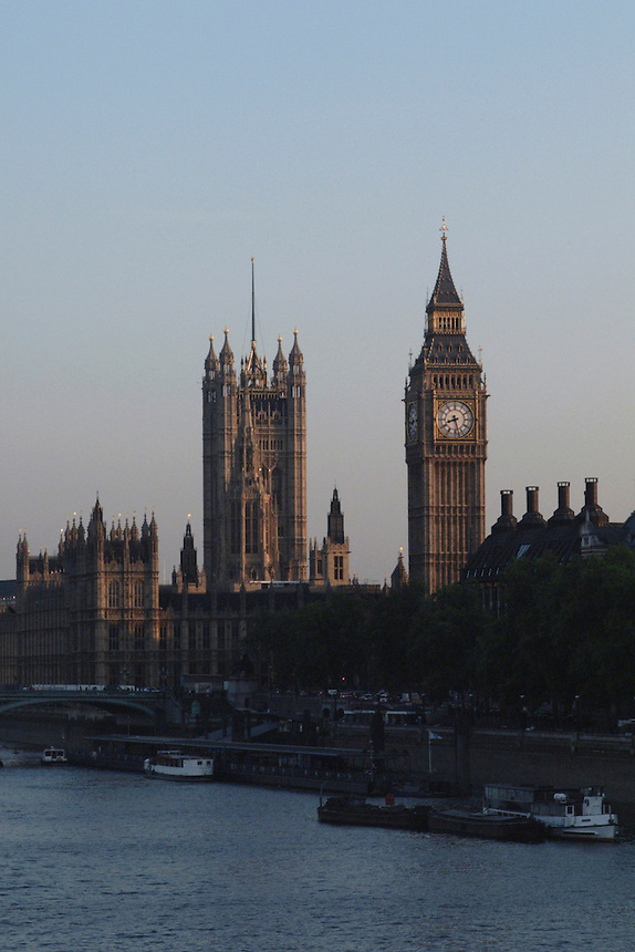 Late afternoon view of Parliament and Big Ben over the Thames in London, England.