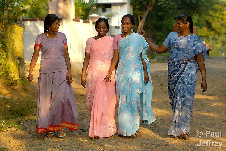 Indian women walking in the village of Agaramthem.