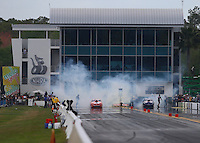 Mar 14, 2015; Gainesville, FL, USA; Overall view of Auto Plus Raceway at Gainesville as NHRA pro stock driver Drew Skillman (left) does a burnout alongside Jason Line during qualifying for the Gatornationals. Mandatory Credit: Mark J. Rebilas-