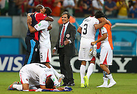 Costa Rica coach Jorge Luis Pinto joins in the celebrations with his players after winning the penalty shoot out and progressing to the quarter finals