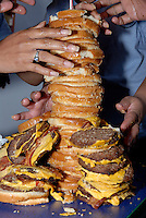 Contestants work to build the highest tower of burgers at the &quot;Burger King Stackers Stack-Off&quot; at the Burger King restaurant in McDonough, Ga. Teams were given 15 minutes, 25 Double Stacker burgers, four straws and a tray and were allowed to use them in any configuration. The winning team received $1,500. <br />