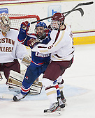 Ryan McGrath (UML - 10), Steven Santini (BC - 6) - The Boston College Eagles defeated the visiting University of Massachusetts Lowell River Hawks 3-0 on Friday, February 21, 2014, at Kelley Rink in Conte Forum in Chestnut Hill, Massachusetts.