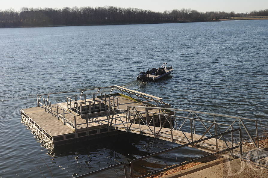 NWA Democrat-Gazette/FLIP PUTTHOFF <br /> A courtesy dock at the boat ramp    Feb. 17 2017    gives anglers a place to fish and helps in boat launching.