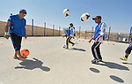 Boys enjoy a safe place to play and have fun in a program run by the Lutheran World Federation in the Zaatari refugee camp near Mafraq, Jordan. Established in 2012 as Syrian refugees poured across the border, the camp held more than 80,000 refugees by 2015, and was rapidly evolving into a permanent settlement. The Lutheran World Federation is a member of the ACT Alliance, which provides a variety of services to refugees living in the camp.