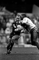 Pix:Michael Steele/SWpix...Great Britain v New Zealand, Maine Road. Rugby League. From the book 'When Push Comes to Shove'....COPYRIGHT PICTURE>>SIMON WILKINSON..Great Britains Martn Offiah makes a tackle on New Zealands Dean Bell.