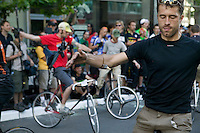2 July 2005 - Jersey City, NJ, USA - Riders compete in a track stand, which requires them to balance on their fixed gear bikes for as long as possible while progessively removing a hand, both hands and a foot from the bike, in the 13th annual cycle messenger world championships, Jersey City, USA, July 2nd 2005. More than 700 riders from all over the world took part in the 4-day competition which carries event based on the daily work of a city bike messenger.