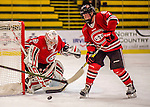 25 November 2016: Saint Cloud State Huskie Defender Brittney Anderson, a Junior from Hudson, WI, clears a rebound off Goaltender Janine Alder, a Freshman from Zurich, Switzerland, during a game against the University of Vermont Catamounts at Gutterson Fieldhouse in Burlington, Vermont. The Lady Cats defeated the Huskies 5-1 to take the first game of the 2016 Windjammer Classic Tournament. Mandatory Credit: Ed Wolfstein Photo *** RAW (NEF) Image File Available ***