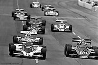 HAMPTON, GA - APRIL 22: Bobby Unser (#12 Penske/Cosworth TC) and Joe Saldana (#69 Lightning 77/Offenhauser TC) lead a group of cars on the front straight during the Gould Twin Dixie 125 event on April 22, 1979, at Atlanta International Raceway near Hampton, Georgia.