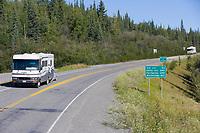 Motor homes travel the Alaska Canada highway at the border crossing between the Yukon Territory Canada, and Alaska, USA.