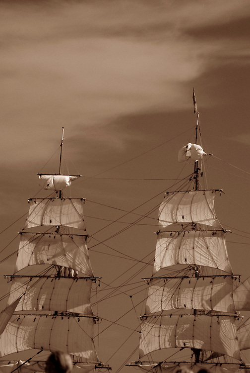 """Masts and sails of barque """"Europa"""" billowing in the wind at Tall Ships Festival 2002, Steveston BC"""