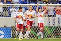 Sinisa Ubiparipovic (8) of the New York Red Bulls celebrates scoring during a Major League Soccer (MLS) match against the Houston Dynamo at Red Bull Arena in Harrison, NJ, on June 2, 2010.
