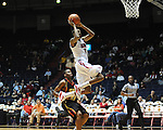 "Mississippi's Jamal Jones (3) scores as Grambling State's Demetri Wheeler (23) during the first half at the C.M. ""Tad"" Smith Coliseum in Oxford, Miss. on Monday, November 14, 2011."