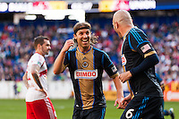 Conor Casey (6) of the Philadelphia Union celebrates scoring with Jeff Parke (31). The New York Red Bulls defeated the Philadelphia Union 2-1 during a Major League Soccer (MLS) match at Red Bull Arena in Harrison, NJ, on March 30, 2013.