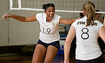 Times Herald-Record/TOM BUSHEY.Pine Bush's Jovonna Rodriguez, left, celebrates with teammate Kourtney Clark during the Section 9 Class AA championship match against Minisink Valley yesterday at Orange County Community College in Middletown..Nov. 5, 2005.