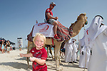 Banjo Nicholson thinks its a great laugh seeing dad on a camel. Volvo Ocean Race Skippers with the Camels that will carry them to the boats for the start of the in Port Race in Abu Dhabi. Volvo Ocean Race 2011 2012. 13/1/2012