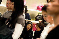 Clients are discussing in a showcase of the designer Valentino in a mall of Beijing, near the business center of Guomao.