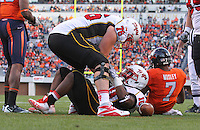 Nov 13, 2010; Charlottesville, VA, USA; Maryland Terrapins running back D.J. Adams (10) celebrates with teammate Maryland Terrapins offensive linesman R.J. Dill (76) after scoring a touchdown during the 1st half of the game against the Virginia Cavaliers at Scott Stadium.  Mandatory Credit: Andrew Shurtleff-