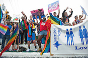 N.C. Pride Parade participants from Duke's Center for LGBT Life wave to the crowd in Durham on Saturday, Sept. 29, 2012, at the corner of Main and Broad streets.