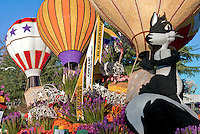 Flower covered floats used in 2010  Rose Parade, Tournament of Roses, Pasadena; Pepe le Pew, Penelope Pussycat, colorful hot air balloons, State of New Mexico Grand Marshal's Trophy