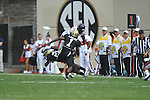 Ole Miss' Ferbia Allen (83) is tackled by Vanderbilt defensive back Andre Hal (23) and Vanderbilt safety Kenny Ladler (1) in Nashville, Tenn. on Saturday, September 17, 2011. Vanderbilt won 30-7..