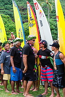 North Shore, Oahu, Hawaii (December 5, 2013) Hokule'a crew with Ross Clarke Jones (AUS) and Tom Carroll (AUS). -- The 29th annual Quiksilver In Memory of Eddie Aikau, the original one-day big wave invitational surfing event, officially opened its holding period with the traditional Hawaiian Opening Ceremony at Waimea Bay today, December 5, at 3pm. Event Invitees and Alternates joined with the Aikau Family and Hawaiian Kahu Billy Mitchell to honor Aikau and welcome the winter big wave period. The Hokule'a, the replica of a traditional Hawaiian voyaging canoe anchored in The Bay during the ceremony with the crew coming ashore and joining the circle. Photo: joliphotos.com