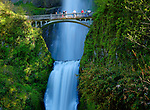 Oregon,Columbia Gorge, Cascade Locks. Mid section view of Multnomah Falls and tourists on the bridge in Spring.