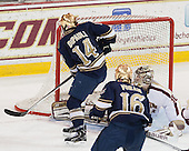 Thomas DiPauli (ND - 14) scores. - The visiting University of Notre Dame Fighting Irish defeated the Boston College Eagles 7-2 on Friday, March 14, 2014, in the first game of their Hockey East quarterfinals matchup at Kelley Rink in Conte Forum in Chestnut Hill, Massachusetts.
