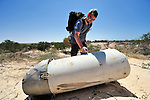 Johnny Thomsen, a Danish explosive ordnance disposal technician, marks a portion of a Russian-built SA3 missile on June 15 at a former Libyan Air Force site outside Misrata, the besieged Libyan city where civilians and rebel forces are surrounded on three sides by forces loyal to Libyan leader Moammar Gadhafi. Several missiles here were damaged in a NATO air strike, and a team from the ACT Alliance, concerned about the safety of civilians traveling a nearby road, investigated the site and marked which items need to be safely removed. Thomsen is marking this booster element of the missile as not posing a threat. Thomsen works with the humanitarian mine action program of DanChurchAid, which is a member of the ACT Alliance.  Photo by Paul Jeffrey/ACT Alliance.