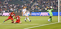 CARSON, CA – June 3, 2011: LA Galaxy forward Chad Barrett (11) takes a shot on goal but it does not get past DC United goalie Bill Hamid (28) during the match between LA Galaxy and DC United at the Home Depot Center in Carson, California. Final score LA Galaxy 0, DC United 0.