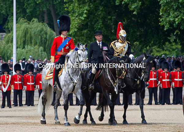 "PRINCE WILLIAM RIDES AT TROOPING 2011.Prince William riding a grey mount had a trial run a week prior to the Trooping of the Colour..The Duke who for the first time will be riding alongside The Queen and his father Prince Charles in next week's Trooping the Colour, joined the full dress rehearsal at Horse Guards, London..The salute at the rehearsals was taken by his uncle the Duke of Kent..Prince William who is the Colonel of the Irish Guards was wearing their colours in his bearskin. The Trooping of Colour marks the official birthday of The Queen, London_04/06/2011.Mandatory Credit Photo: ©FRANCIS DIAS-NEWSPIX INTERNATIONAL..**ALL FEES PAYABLE TO: ""NEWSPIX INTERNATIONAL""**..IMMEDIATE CONFIRMATION OF USAGE REQUIRED:.Newspix International, 31 Chinnery Hill, Bishop's Stortford, ENGLAND CM23 3PS.Tel:+441279 324672  ; Fax: +441279656877.Mobile:  07775681153.e-mail: info@newspixinternational.co.uk"