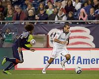 Toronto FC midfielder Dwayne De Rosario (14) dribbles as New England Revolution defender Kevin Alston (30) defends. The New England Revolution defeated Toronto FC, 4-1, at Gillette Stadium on April 10, 2010.