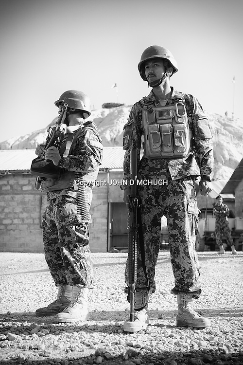 Afghan National Army soldiers prepare to go on patrol alongside US troops from 1-38 Infantry in Pay-E Moluk village in Panjwayi, Kandahar, 30 April 2013. The patrol was ambushed and turned into a five hour firefight. (John D McHugh)