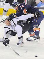 San Antonio Rampage's Mark Cullen, left, battles Oklahoms City Barons' Teemu Hartikainen for the puck during the first period of an AHL hockey game, Monday, May 7, 2012, in San Antonio. (Darren Abate/pressphotointl.com)
