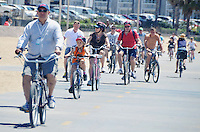 A group of  tourist from Australia ride bicycles along the bike path while on a Legend Beach Bike guided tour on Monday, August 27, 2012.