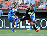 Chris Pontius (13) of D.C. United goes against Steven Beitashour (33) of the San Jose Earthquakes.  D.C. United defeated the San Jose Earthquakes 1-0, at RFK Stadium, Saturday June 22 , 2013.
