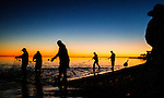 Personal Work<br /> <br /> On the day before Thanksgiving,  commercial fishermen wait for the mullet run to strike their net in the Gulf at Shell Point in Wakulla County, Florida.