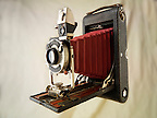 Kodak Brownie folding camera with red bellows & Kolios shutter